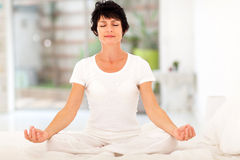 Woman meditation home Stock Images