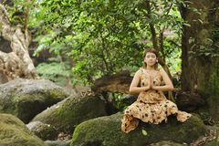 Woman meditation in nature Stock Photo