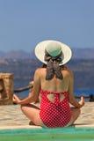 Woman meditation near the pool Royalty Free Stock Photos