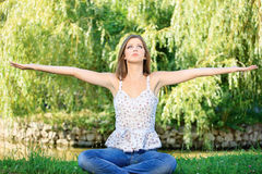 Woman at meditation outdoor. Young woman in lotus pose at the meditation outdoor Stock Image