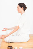A woman in a meditation position Stock Image