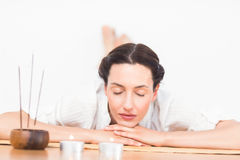 A woman in a meditation position Stock Photography