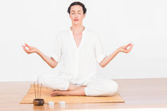 A woman in a meditation position Royalty Free Stock Photography
