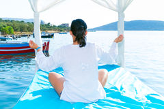 Woman at meditation  on the sea coast,. Crete Royalty Free Stock Images