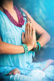 Woman in meditation yoga position closeup Stock Photo