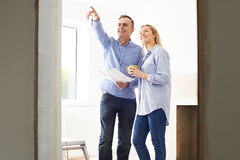 Woman Meeting With Architect Or Builder In Renovated Property Royalty Free Stock Image