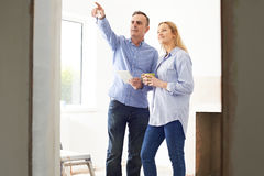 Woman Meeting With Architect Or Builder In Renovated Property Royalty Free Stock Images