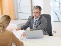 Woman meeting banking advisor Stock Photos