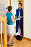 Woman meeting cleaner at door Stock Photography