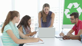 Woman meeting with colleagues about environmental awareness stock video footage