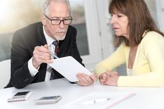 Woman meeting a consultant for advices, light effect. Financial consultant giving advices to female client, light effect royalty free stock image