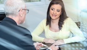 Woman meeting financial adviser in office;light effect. Smiling young women meeting a financial adviser; light effect stock images