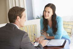 Woman Meeting With Financial Advisor At Home Royalty Free Stock Photo
