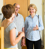 Woman meeting friends at the door Royalty Free Stock Photography