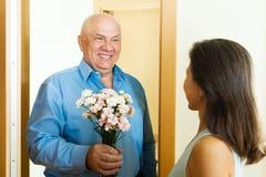 Woman meeting her mature man Stock Photo