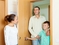 Woman meeting husband and son. In the doorway Royalty Free Stock Photography