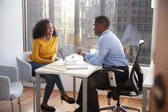 Woman Meeting With Male Financial Advisor Relationship Counsellor In Office royalty free stock photography
