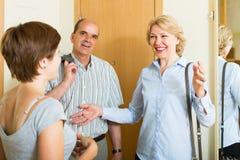 Woman meeting mature friends Stock Photos