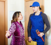 Woman meeting service worker Royalty Free Stock Photography