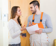 Woman meeting service worker Stock Photos