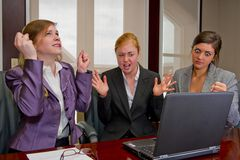 Woman Meeting Showing Frustration with Computer. Woman meeting at the computer showing frustration Royalty Free Stock Photo