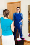 Woman meeting smiling cleaner Stock Photo