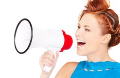 Woman with megaphone. Picture of redhead woman with megaphone over white Royalty Free Stock Photo