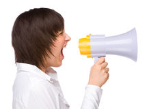 Woman With Megaphone. Full isolated portrait of a caucasian woman shouting with a megaphone Stock Photo