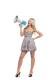 Woman with megaphone. Young blonde woman  with megaphone Royalty Free Stock Photos