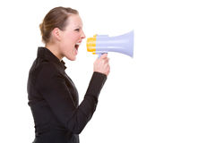 Woman with megaphone. Full isolated portrait of a beautiful caucasian businesswoman shouting with a megaphone Royalty Free Stock Photography