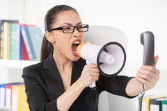 Woman with megaphone. Royalty Free Stock Image