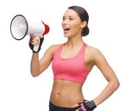 Woman with megaphone. Picture of beautiful sporty woman with megaphone Stock Image