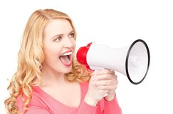 Woman with megaphone. Picture of woman with megaphone over white Royalty Free Stock Image