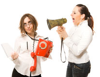 Woman with megaphone screaming to secretary Stock Photography