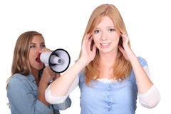 Woman with megaphone shouting Stock Image