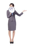 Woman with megaphone show something Royalty Free Stock Photography
