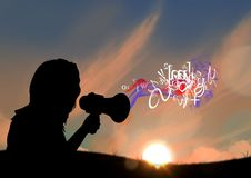 Woman with megaphone silhouette in sunset with text and smoke coming up from the megaphone Royalty Free Stock Photography