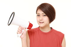 Woman with megaphone Stock Image
