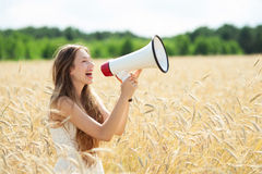 Woman with megaphone in the wheat field Royalty Free Stock Photography