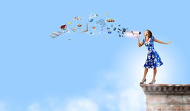 Woman with megaphone Royalty Free Stock Images