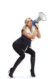 Woman with megaphone. Young fashionable woman shouting in a megaphone Royalty Free Stock Photos