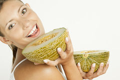 Woman with melon Royalty Free Stock Photo