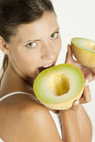 Woman with melon galia Royalty Free Stock Photo