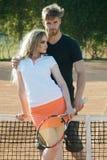 Woman and man athletes hold tennis racket stock photos