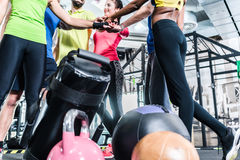 Woman and men being motivated for fitness and sport. Stacking their hands Stock Images