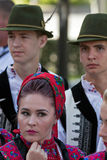 Woman and men from Romania in traditional costume Stock Photo