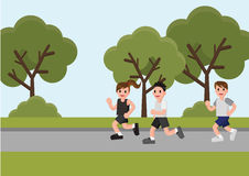 Woman and Men running in the park. Stock Photos