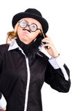 Woman in drag talking on phone Stock Photography