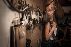 Woman with men's tools stock images