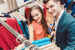 Woman and man shopping fashion in a store Stock Image